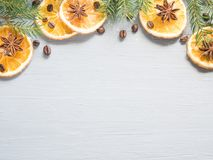 Abstract Christmas background with citrus fruit, slices of orange and star anise. Copy space Stock Photos