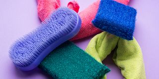 Abstract background with cleaning cloths, sponges. Colorful washing concept Stock Photos