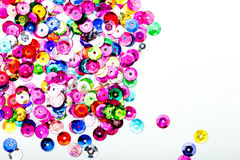 Abstract Background - close up of multi colored sequins on white. Abstract Background - close up of shiny multi colored round sequins on white background royalty free stock photo