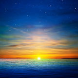 Abstract background with clouds and sea sunrise. Abstract blue background with stars and golden ocean sunrise Stock Image