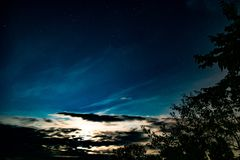 Background with clouds, stars and the light of the rising sun. Abstract background with clouds, stars and the light of the rising sun royalty free stock images