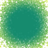 Abstract background with a clover. A card for day of Patrick. A green background with a luminescence Royalty Free Stock Image