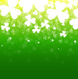 Abstract background with a clover. A card for day of Patrick. A green background with a luminescence Stock Photos
