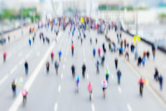 Abstract background of colored group of bicyclists in city center, bike marathon, blur effect, unrecognizable faces Royalty Free Stock Photos