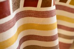 Abstract background colored stripes on the texture of the fabric folded wave royalty free stock photo