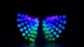 Abstract background colorful blurred bokeh of light moving around. Slow motion stock footage
