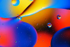 Abstract background of colorful bubbles. Abstract background of colorful bubbles on the surface of water and oil for your design Royalty Free Stock Photos