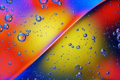 Abstract background of colorful bubbles. Abstract background of colorful bubbles on the surface of water and oil for your design Royalty Free Stock Photo