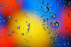 Abstract background of colorful bubbles. Abstract background of colorful bubbles on the surface of water and oil for your design Stock Images