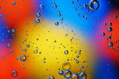 Abstract background of colorful bubbles. Abstract background of colorful bubbles on the surface of water and oil for your design Stock Photography