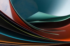 Abstract background.  Colorful curved sheets of paper.  Close-up shot Stock Photography