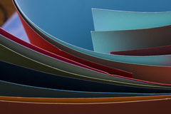 Abstract background.  Colorful curved sheets of paper.  Close-up shot Royalty Free Stock Photos