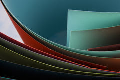 Abstract background.  Colorful curved sheets of paper.  Close-up shot Royalty Free Stock Image