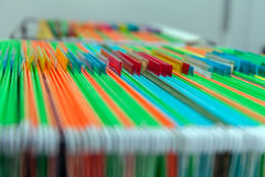 Abstract background colorful hanging file folders in drawer. Stock Image