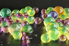 Abstract background with colorful hydrogel orbeez balls stock photos