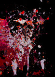 Abstract background of colorful paint splatters on black Stock Photography