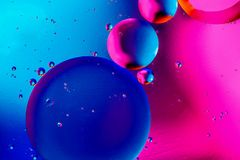 Abstract background with colorful pink blue gradient colors. Oil drops in water abstract psychedelic pattern image.  royalty free stock images