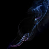 Abstract background with colorful smoke on black Royalty Free Stock Photos