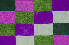 Abstract background with a colorful square pattern. Animated texture with a colorful square pattern.Abstract background. Background is made of purple,green and Vector Illustration