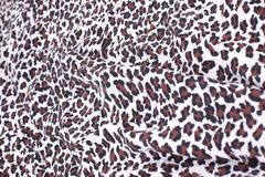 Abstract background composed of leopard print fabric. The concept of creativity royalty free stock photography