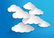 Abstract background composed of white paper clouds over blue. vector illustration.