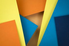 Abstract composition of blue and orange papers. Abstract background a composition of obliquely color paper royalty free stock image