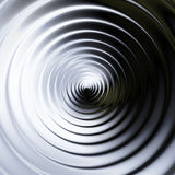 Abstract background of concentric swirling circles creating an illusion of movement. Black and white rotating background resembling molten metal Stock Photo