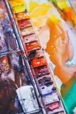 Abstract background concept for school watercolor. Hobbies and education, a cuvette with different watercolors. The artist`s tools while working with paint stock photography