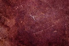 Abstract background of concrete Burgundy color. Painted wall. Homogeneous surface of concrete, plaster painted in Burgundy color. Abstract natural texture for royalty free stock photography