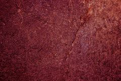 Abstract background of concrete Burgundy color. Painted wall. Homogeneous surface of concrete, plaster painted in Burgundy color. Abstract natural texture for stock images