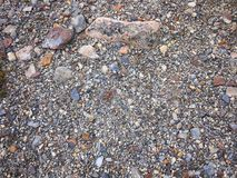 A rocky river bed in Patagonia. An abstract background of a confusion of random sized rocks in a dry river bed royalty free stock images