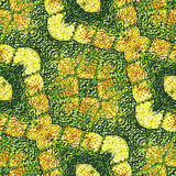 Abstract background with crocodile skin. Gold and green entwined pattern resembling crocodile skin Stock Image