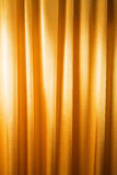 Abstract background, curtain, drapes gold fabric. Crumpled cloth, folds of fabric royalty free stock photography