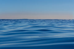Abstract background deep blue ocean motion defocused to pink sky Royalty Free Stock Photo