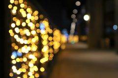 Abstract background of defocused on lights with bokeh effect.  Blurred background, copy space for editing and text stock image