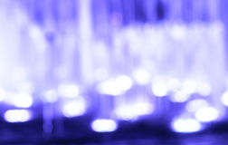 Abstract background defocused lights and fountain Stock Photography