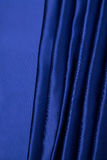 Abstract background, drapery blue fabric. Crumpled cloth, folds of fabric Stock Image
