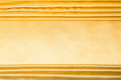 Abstract background, drapery gold fabric. Crumpled cloth, folds of fabric Stock Photos