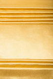 Abstract background, drapery gold fabric. Crumpled cloth, folds of fabric Royalty Free Stock Photos