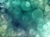Abstract background with a dreamy green bokeh