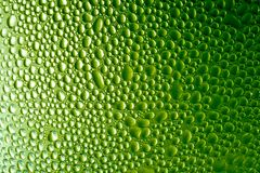 Abstract background, drops. On a backlighted green glass royalty free illustration