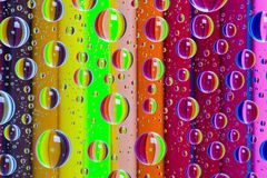 Abstract background with drops and wooden pencils set Royalty Free Stock Image