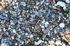 Abstract background with dry reeble stones texture stock photos