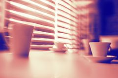 Abstract background duo tone coffee cups on the table lines defocused blurred. Background royalty free stock photo