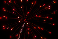 Abstract Background: Expanding Fuzzy Red/Pink Fireworks with Trail Royalty Free Stock Photo