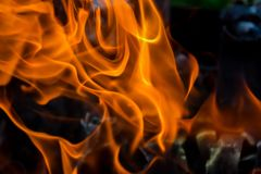 Abstract background of fire, coals, flames and twisting elements of ash.  Stock Images