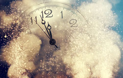 Abstract background with fireworks and clock close to midnight Royalty Free Stock Image