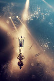 Abstract background with fireworks and clock close to midnight Stock Image