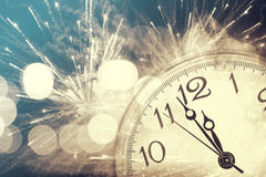 Abstract background with fireworks and clock close to midnight Royalty Free Stock Photo