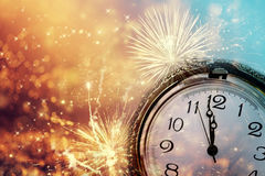 Abstract background with fireworks and clock close to midnight Stock Photography